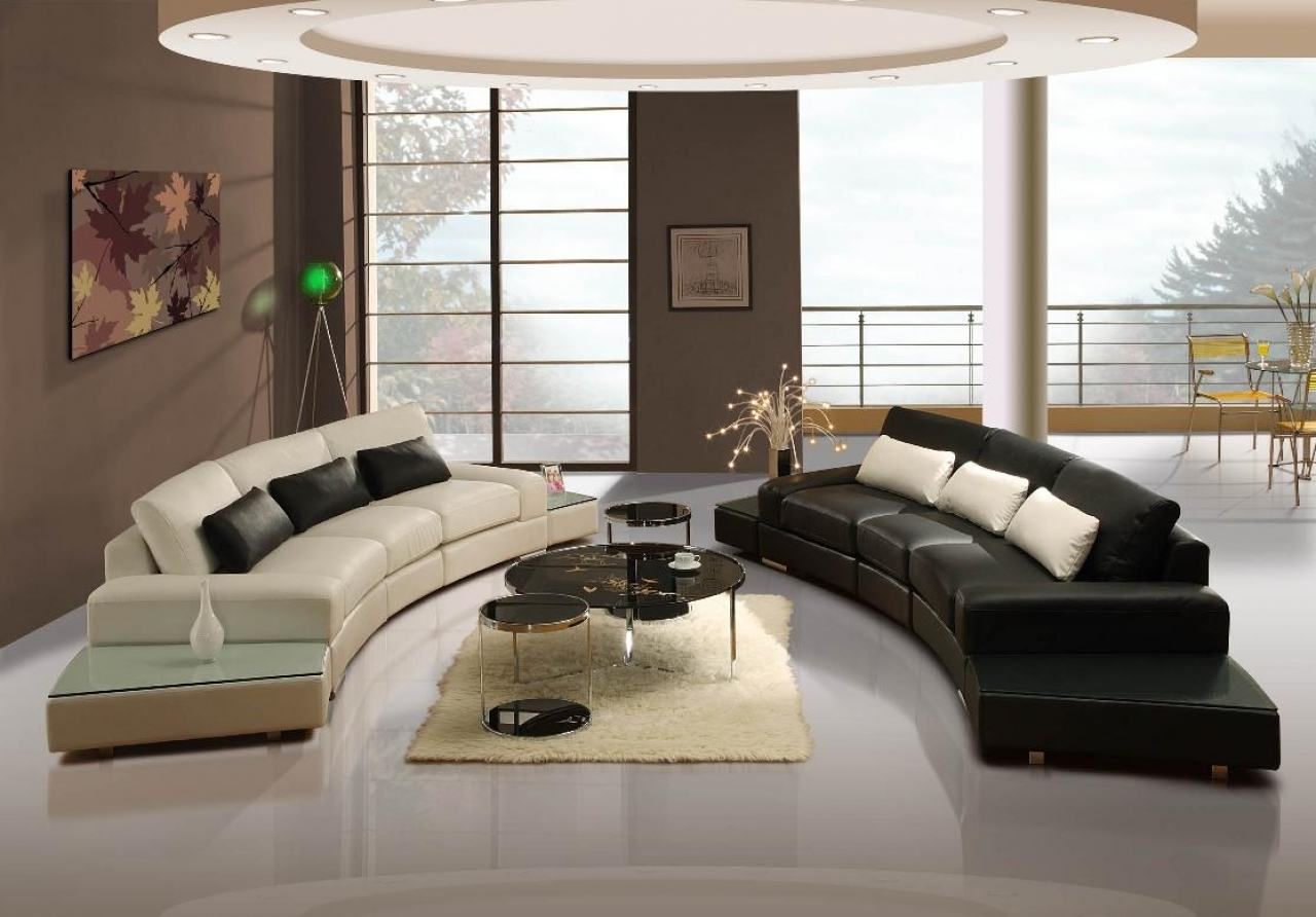 Posh brown and cream interior with two curved sofa facing each other, one white and the other black