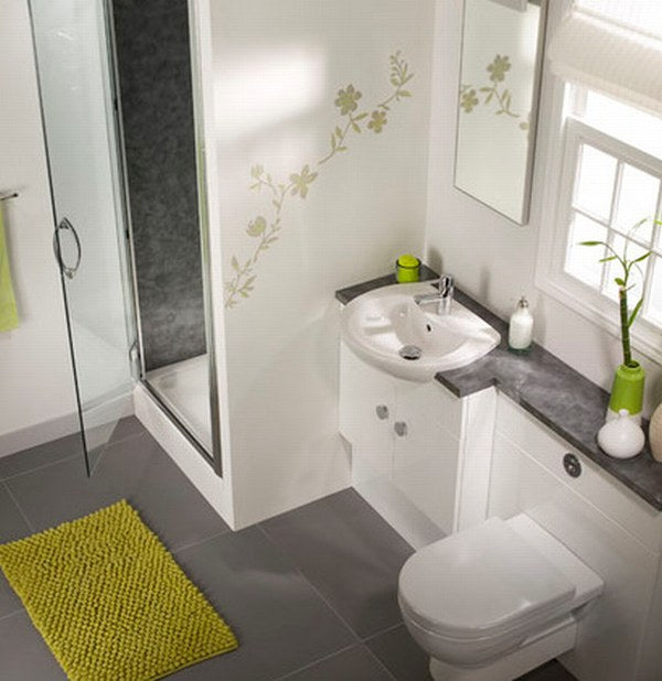 Cream and grey bathroom interior with a light green leaf decal on the wall