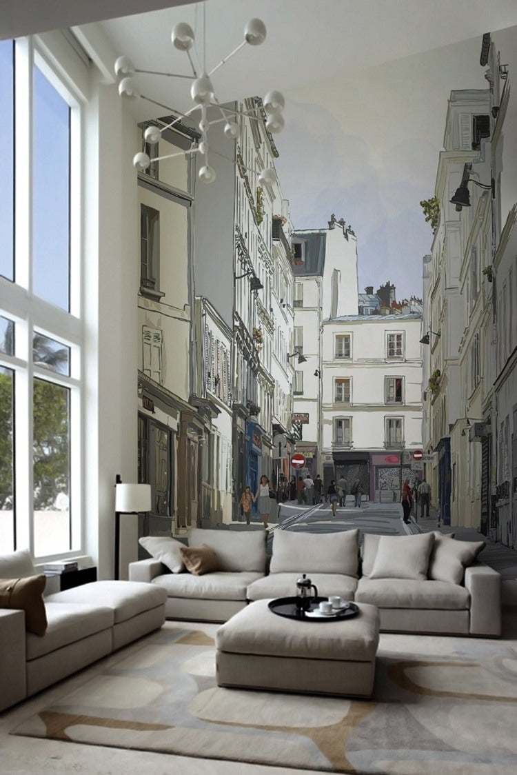 Large ceiling living room, with two beige sofas and a wall decal that looks like a real Parisian side street