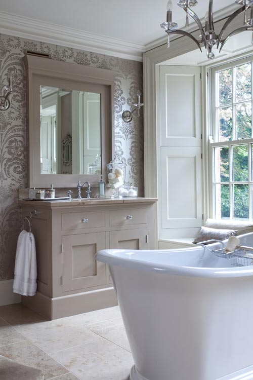 Cream and white bathroom with beige damask wallpaper