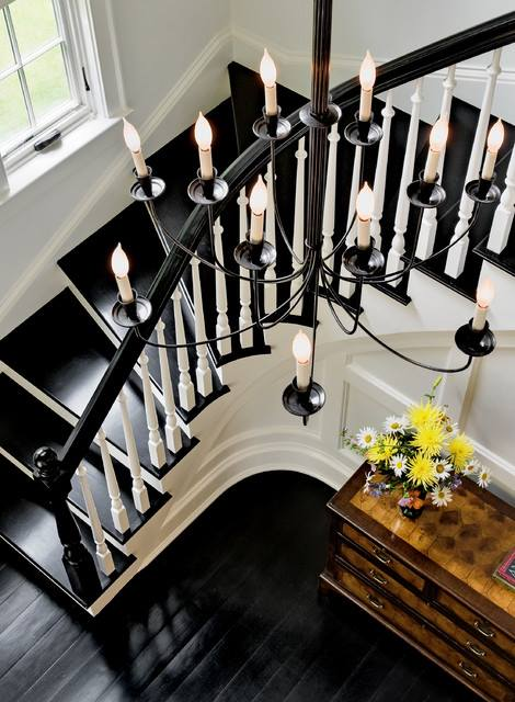 Beautiful black and white staircase with black steps, and black painted floorboards in the hallway