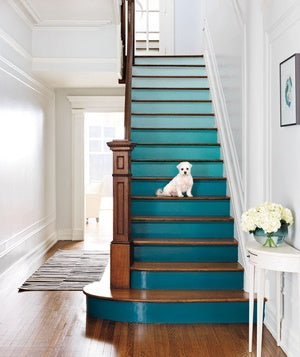 Staircase painted in different shades of blue from teal at the bottom to duck egg at the top