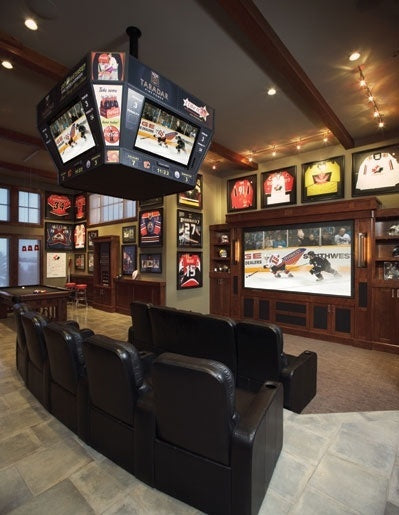 Sports and games room with big TV and leather seats