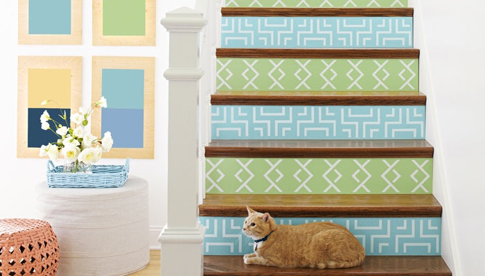 Geometric patterns on the front of steps, alternating with a light blue and light green background colour