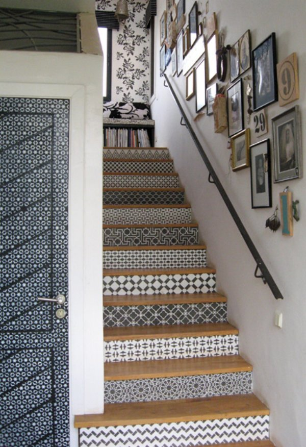 Black and white patterned decal on the front of steps with wood on the top of each step