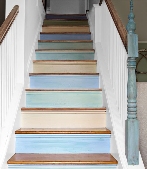 Pastel coloured steps on a staircase in cream, green and blue