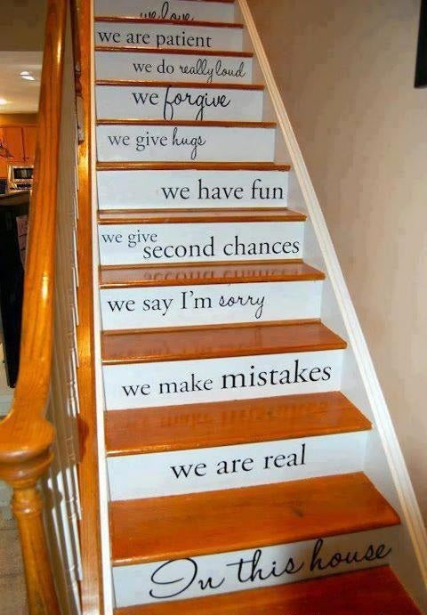 Wooden staircase with motivational quotes on the front of each step