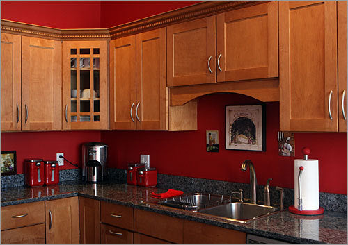Red kitchen color with natural color cabinets terrys for Black red kitchen ideas