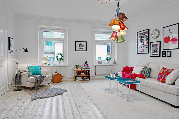 Minimalist Scandinavian living room in white with subtle hints of bright colour