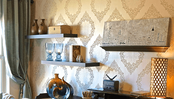 Cream and gold living space, with floating shelves and vintage accessories