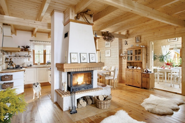 Modern cottage design with lots of exposed wood and a cream fireplace
