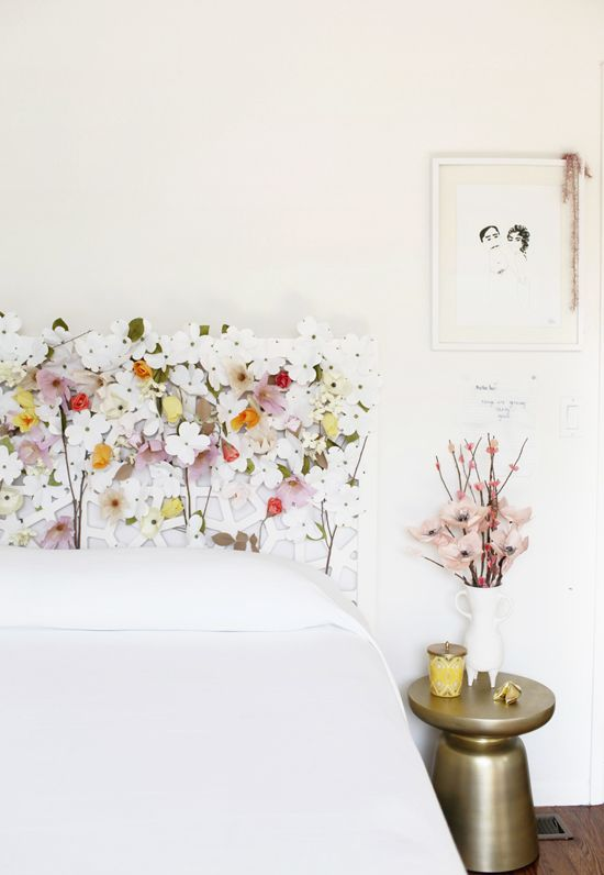 White bedroom design with floral paper decorating the headboard