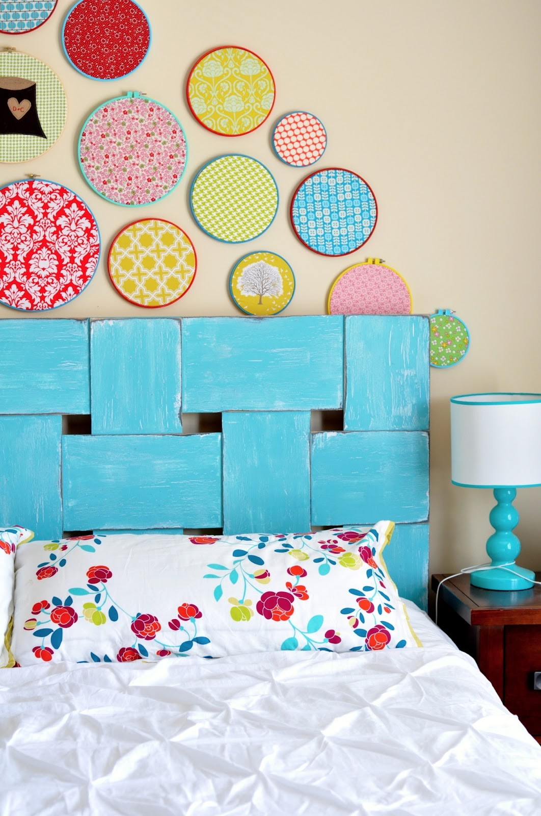 Woven style wood headboard design in a bright blue colour
