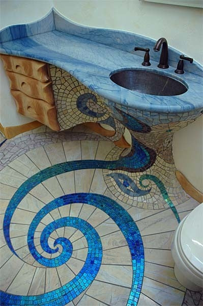 Gaudi inspired tiled bathroom with blue and cream tiles