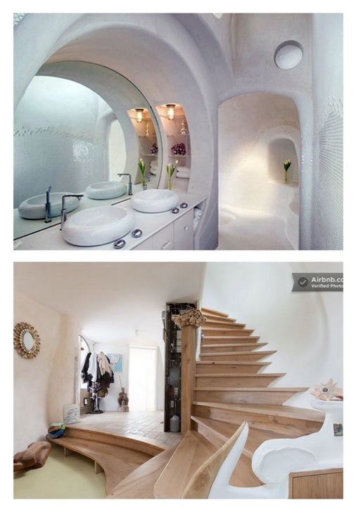 A bathroom and staircase that both look like their in an underground white pebble pod