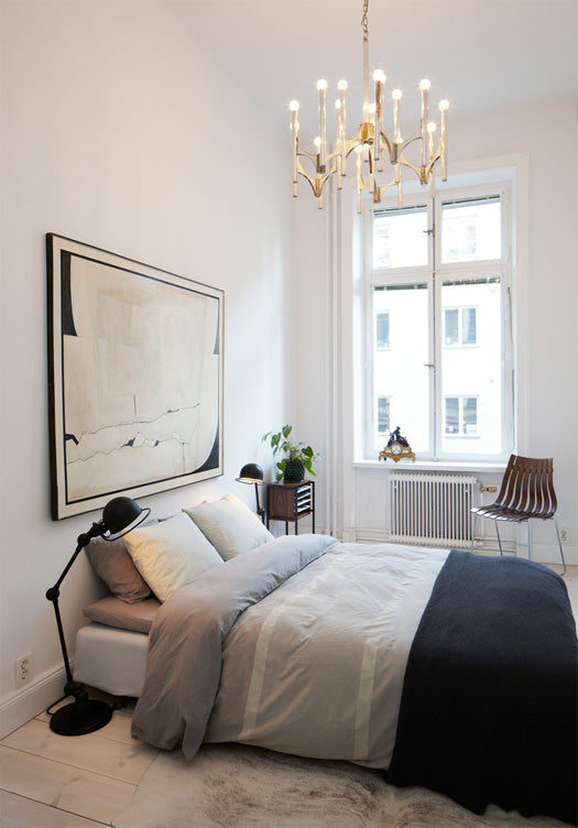 Small bedroom with double bed and chandelier style light fitting