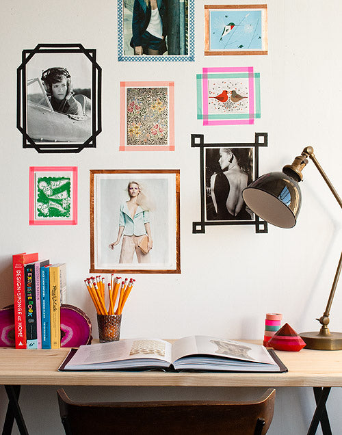 Home office desk with pictures stuck to the wall