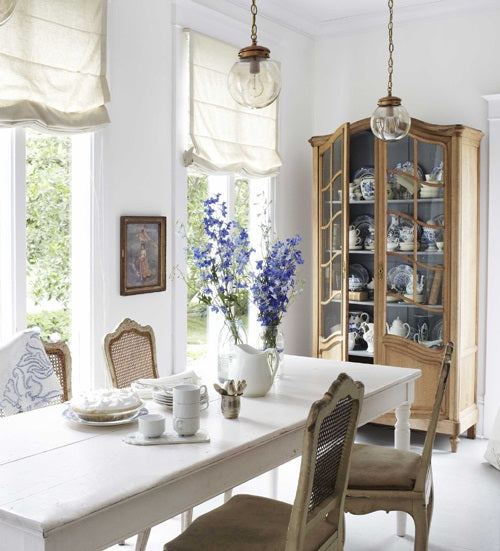 Birght dining room with kitchen cabinet in the corner