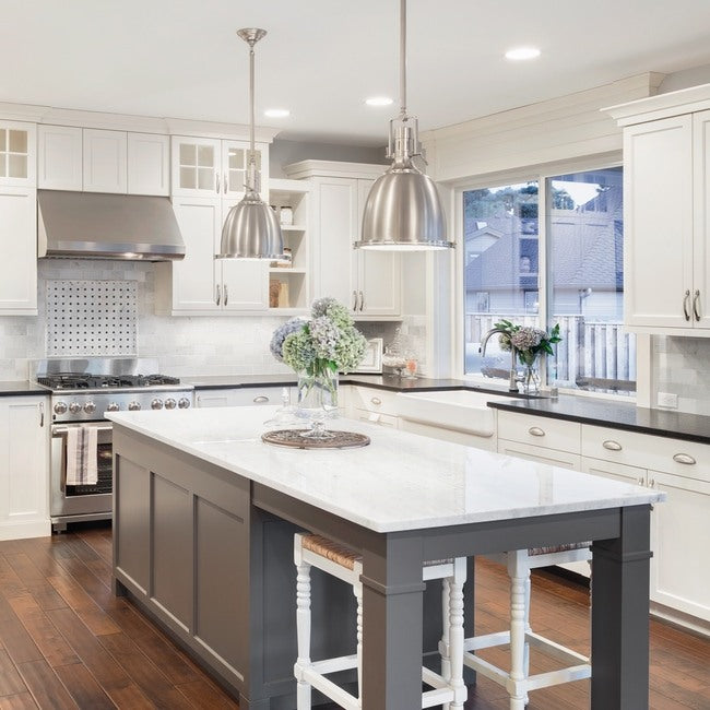Modern cottage appeal is highlighted by white cabinets.