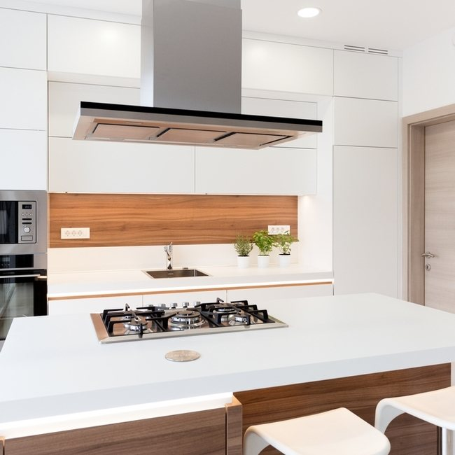 Central islands give a traditionally styled kitchen modern appeal.