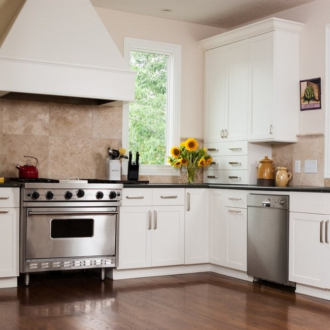 White and cream tiles gives a kitchen a clean, yet traditional look