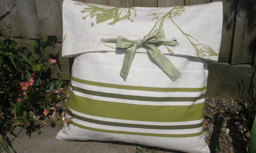 White and green cushion with storage pouch