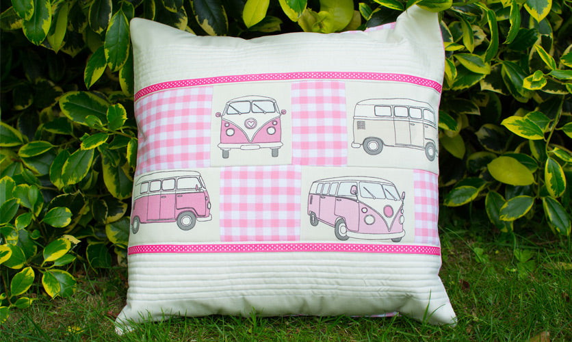 Cream and pink campervan cushion on the grass