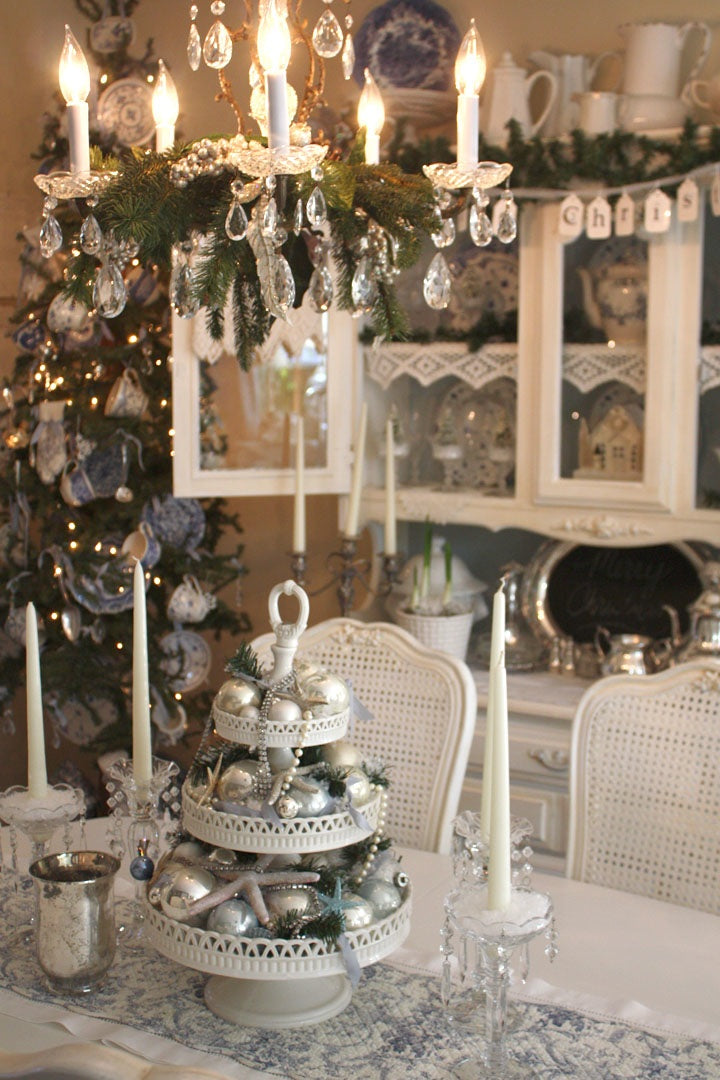 Festive Christmas white dining table, with candle shaped electric chandelier feature