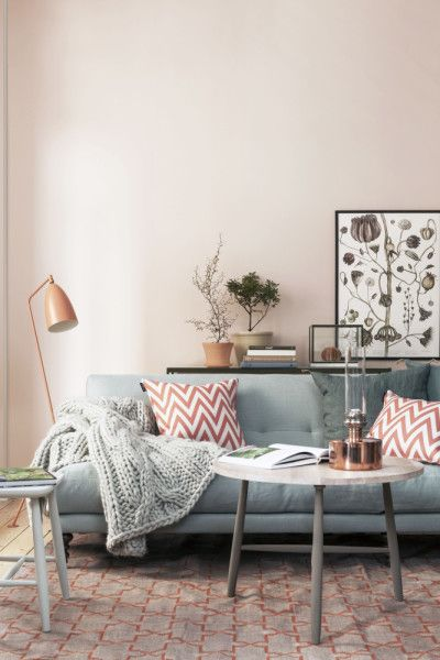 Beige living room with teal sofa and red and white sofa cushion