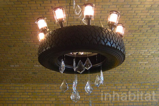 A round rubber tyre suspended from the ceiling and used as a light fixture