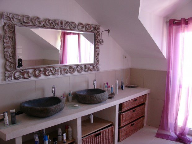 Pink and lilac bathroom with two his and her basin sinks