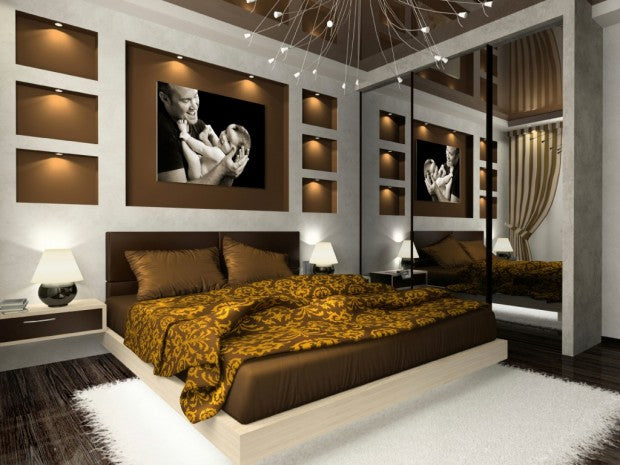 Brown and gold bedroom with father and child photo above the bed