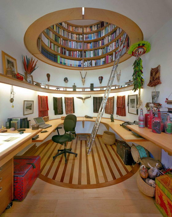 Curved home office with round compartment room in the ceiling with bookshelves curving around the room