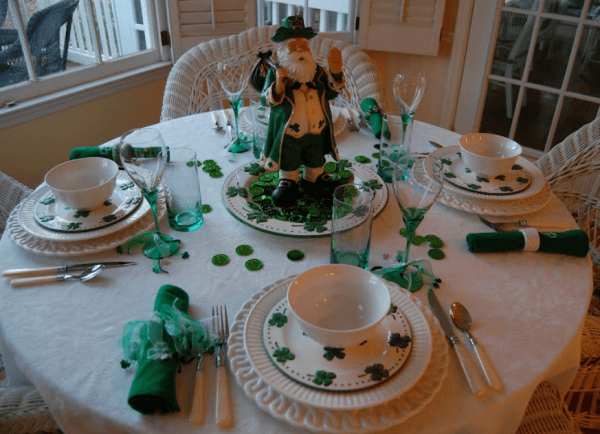 Patrick's day table setting with old man centre piece and green napkins