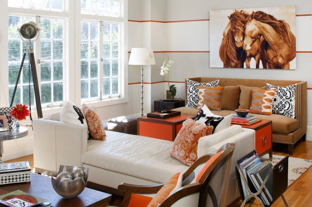 White, brown and orange decor in a sixties style living room