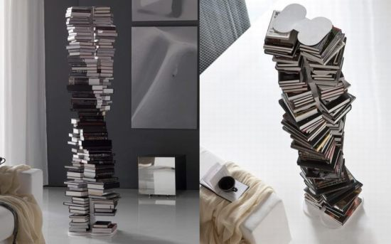 A large pile of books curving upwards, with a central support beam to ensure they don't fall over