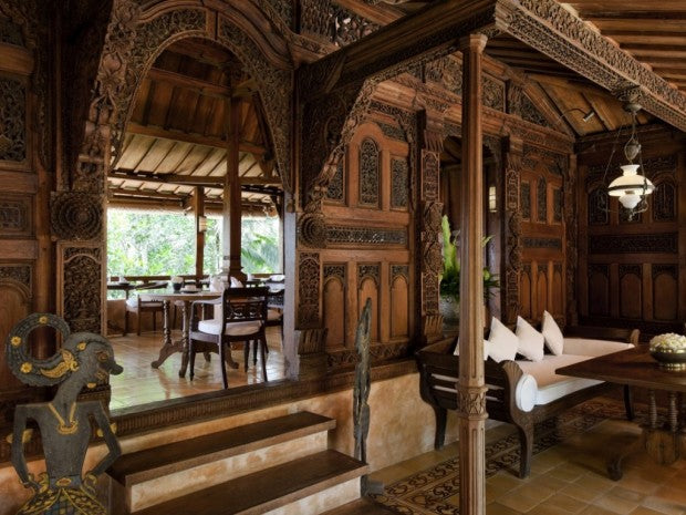 Very traditional living space with intricately carved wooden panels
