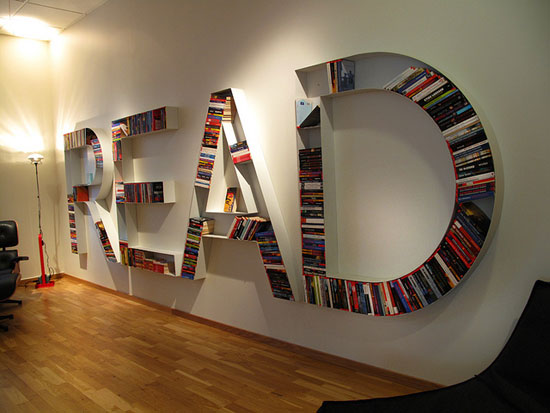 3D wall mounted bookshelves that spell out the word Read