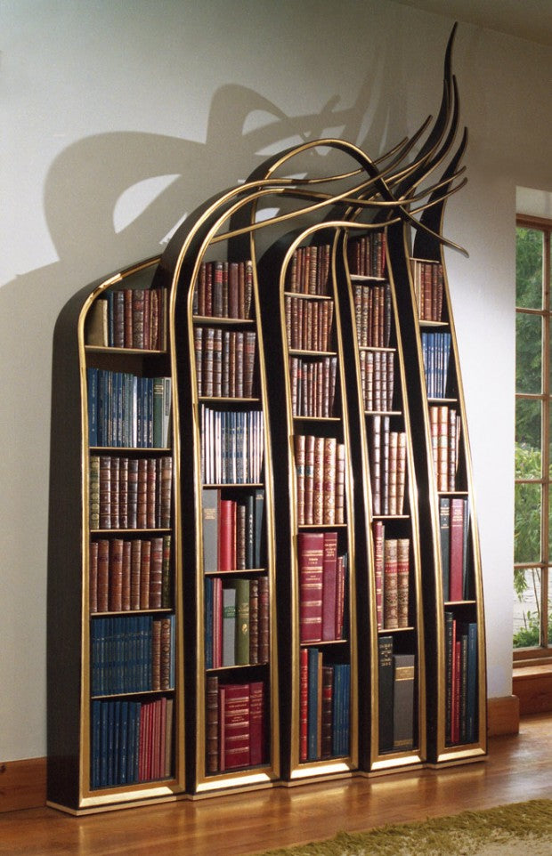 Funky Gothic bookshelves with curving tops that look like grass reed blowing in the wind