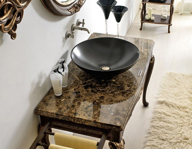 Round black sink on a reflective dressing table