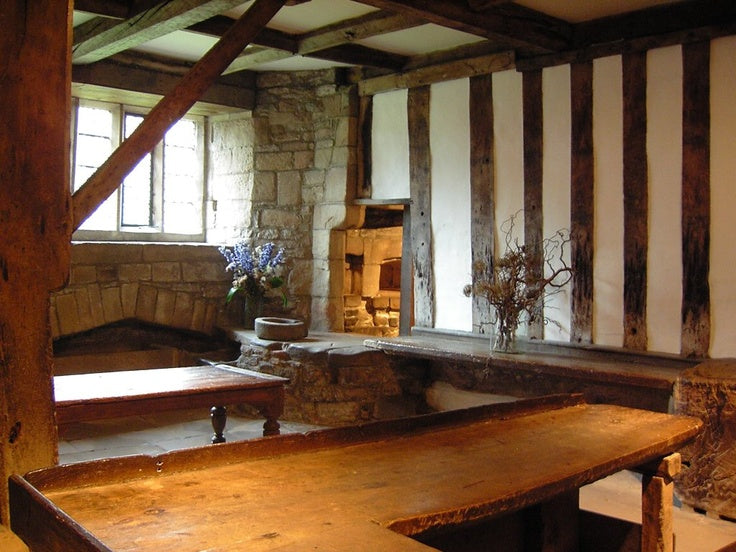 Country kitchen style dining area with exposed wooden beams and white plaster walls