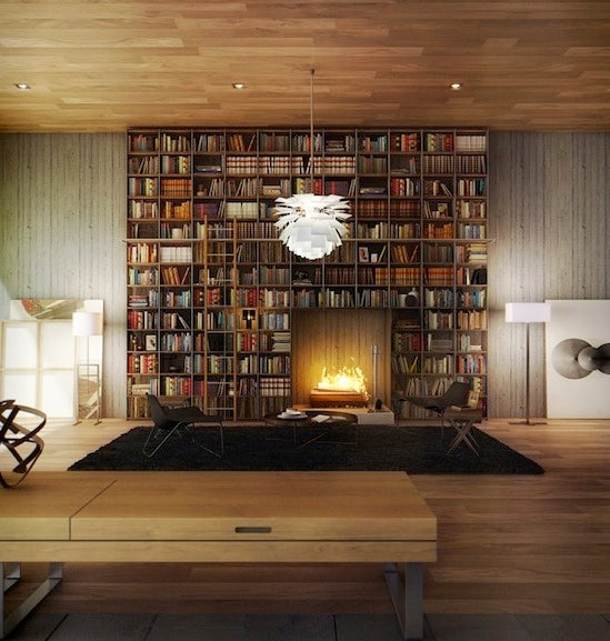 Floor to ceiling bookshelves that wrap around a fireplace