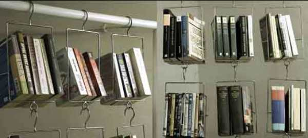 Clothes rail with metal baskets hanging, which contain books
