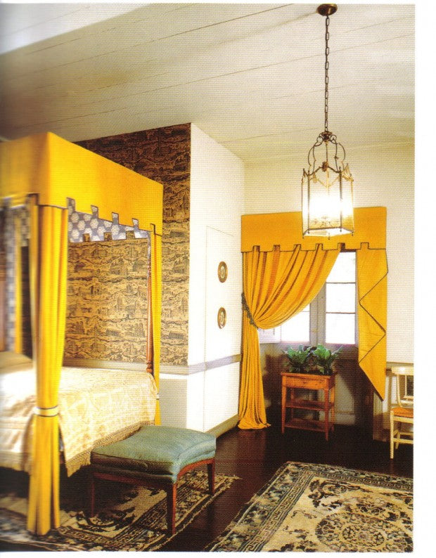 White, gold and yellow bedroom with yellow four poster canopy over a double bed