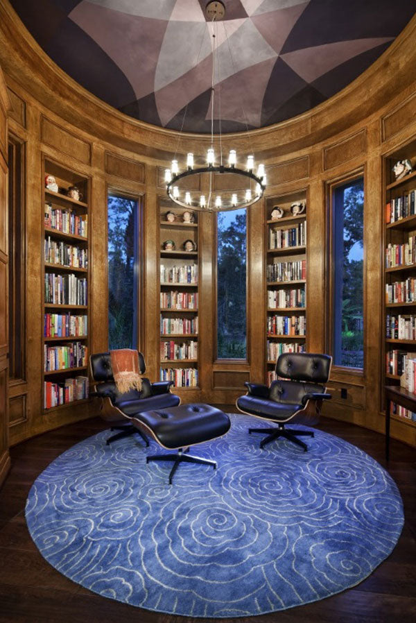Beautiful round reading room with curved wooden bookshelves