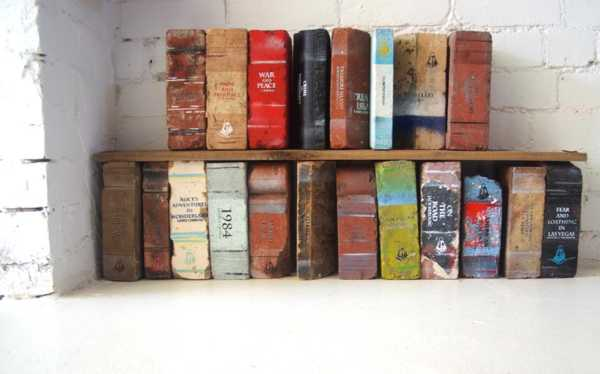 Reclaimed bricks that have been painted to look like books