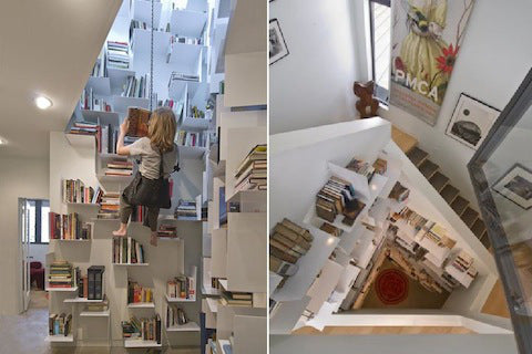 Booksehlves that you can climb up, situated in the centre of a wide meandering staircase