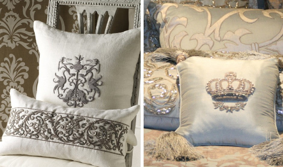 A collection of cream cushions with grey emblem designs