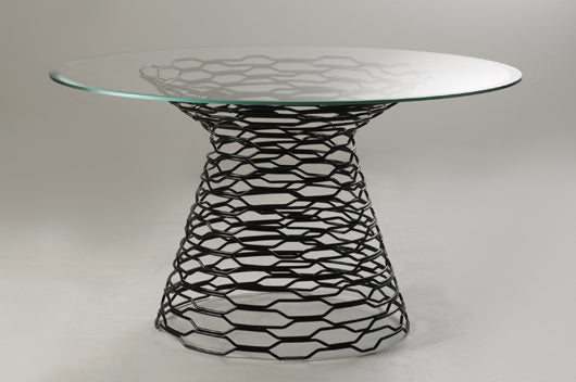 Round glass table on black metalic wire base