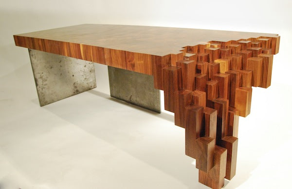 A wooden table with the closest side cascading down like stones at Giants Causeway
